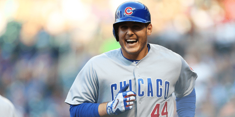 Coral Springs native Anthony Rizzo smiling as he runs on the field
