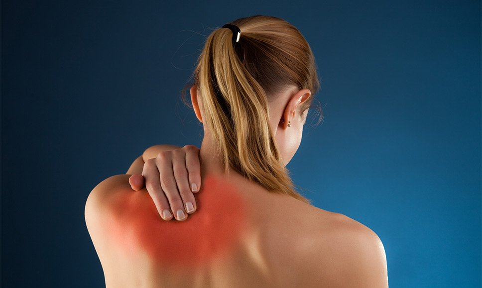 Woman in need of back pain treatment