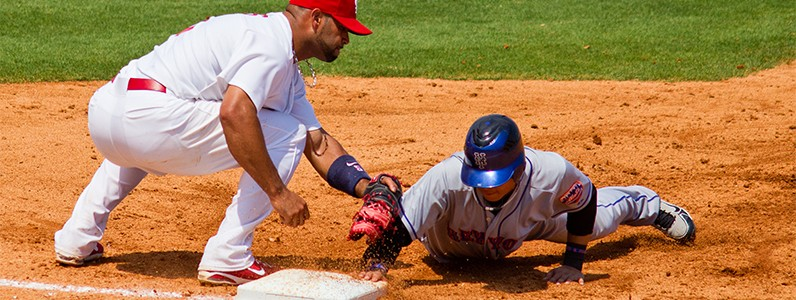 baseball players during game before seeing chiropractic physician