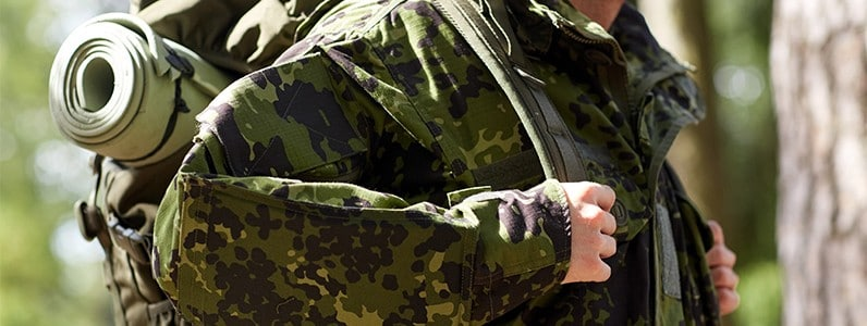 servicemen back pain from packs