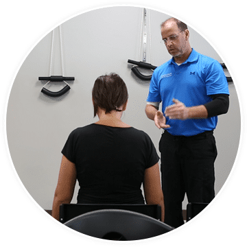 chiropractor explaining physical therapy techniques to a patient