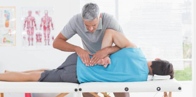 Man receiving chiropractic treatment.