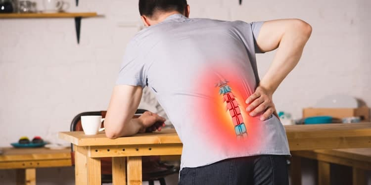 man with herniated disc in pain